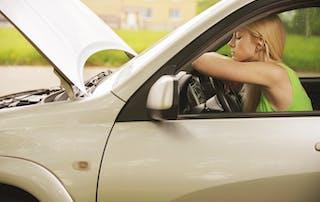 Women in a broken down car