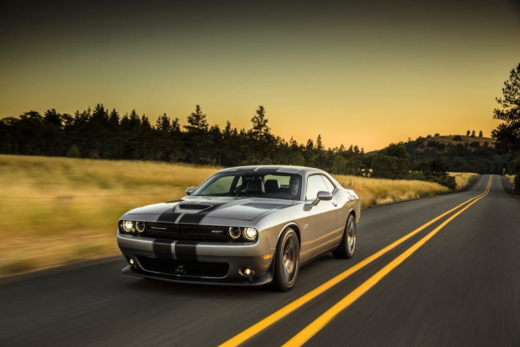 Silver Dodge Challenger with Stripe on the Open Road