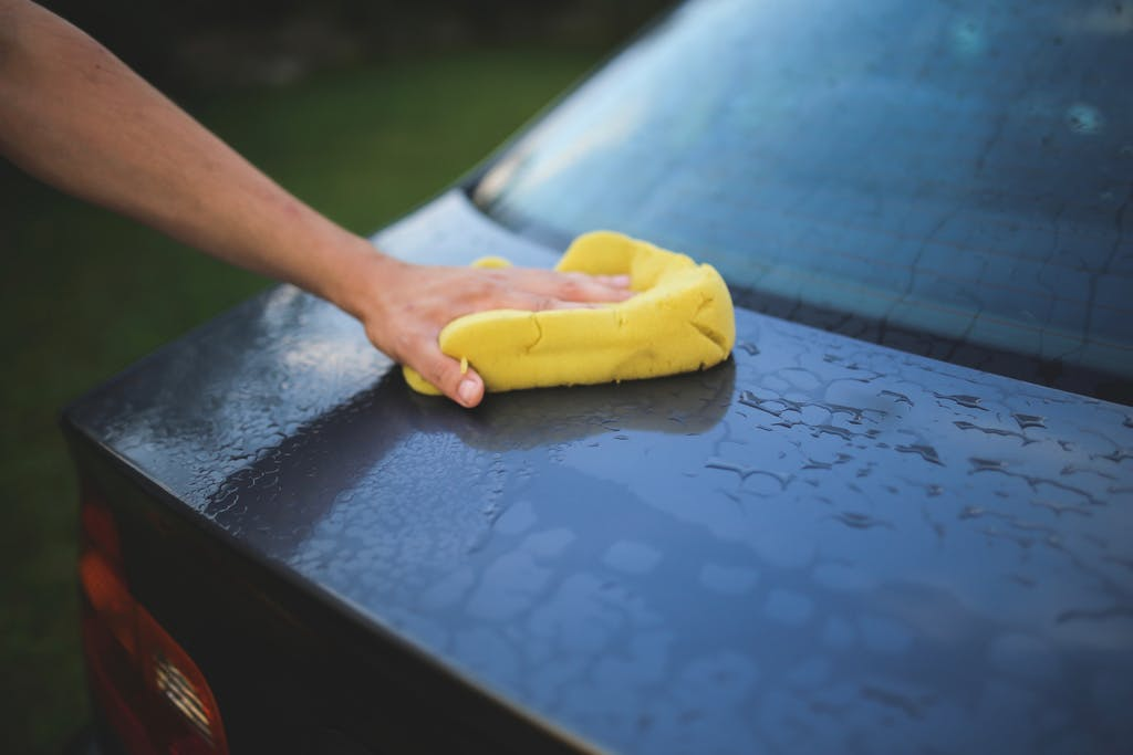 Car being hand washed