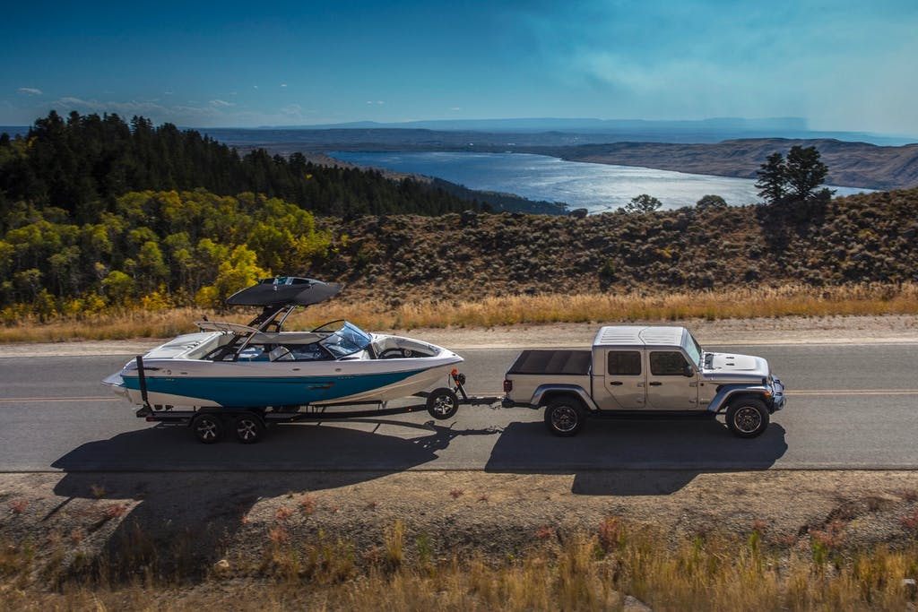 Silver 2020 Jeep® Gladiator Overland towing a Boat