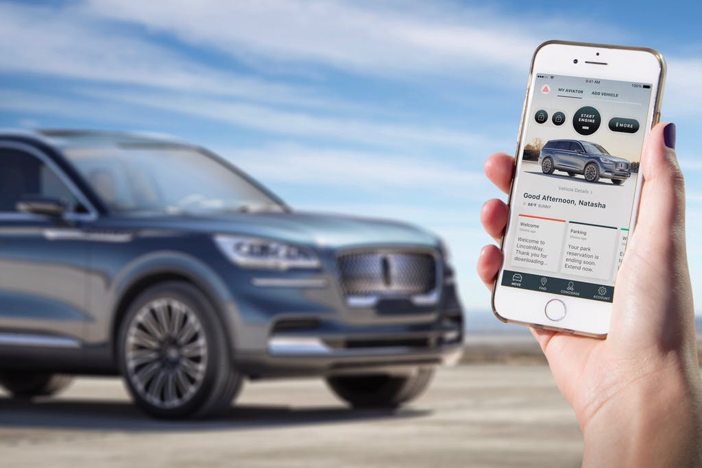 Smart Phone unlocking the Lincoln Aviator in front of the car