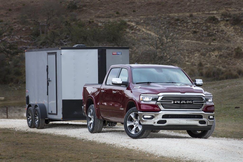 Dark Red 2020 Ram 1500 Laramie towing Trailer