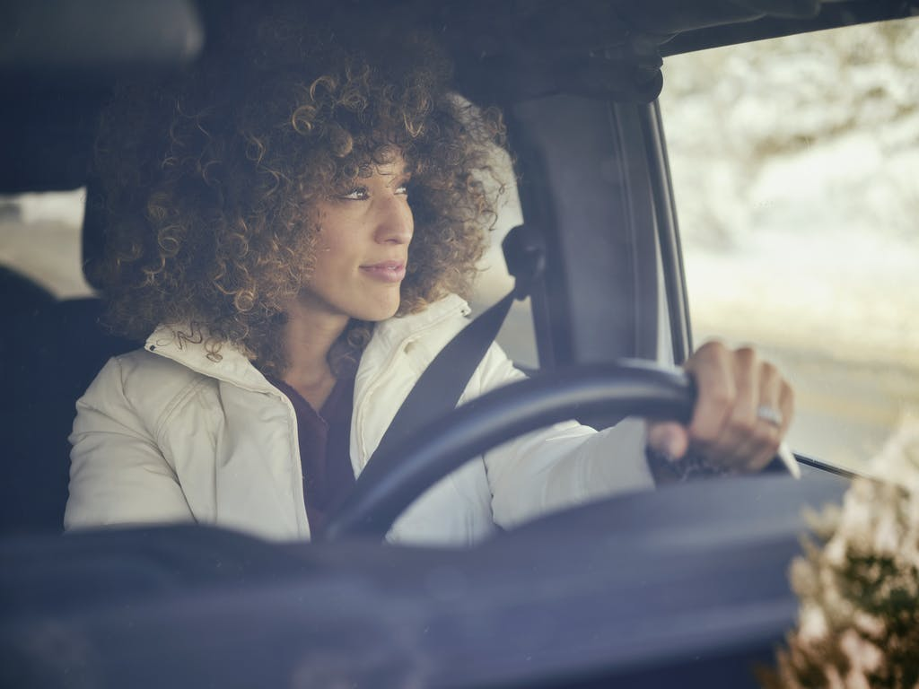 Woman Driving in Car in Winter