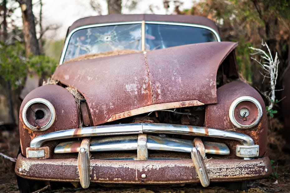 junk car abandoned on a farm