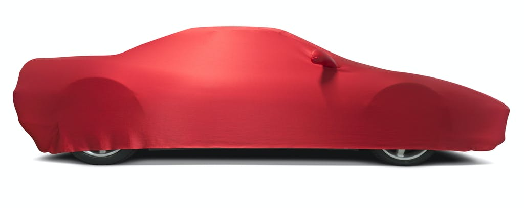 Car Storage Sports car with red protective cover, isolated on white background