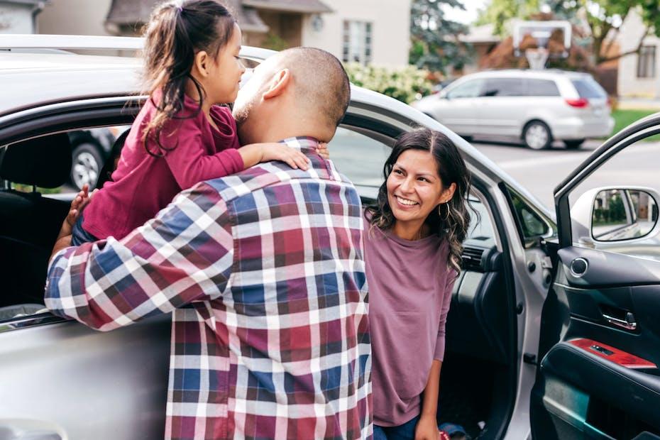 family enjoying their new car