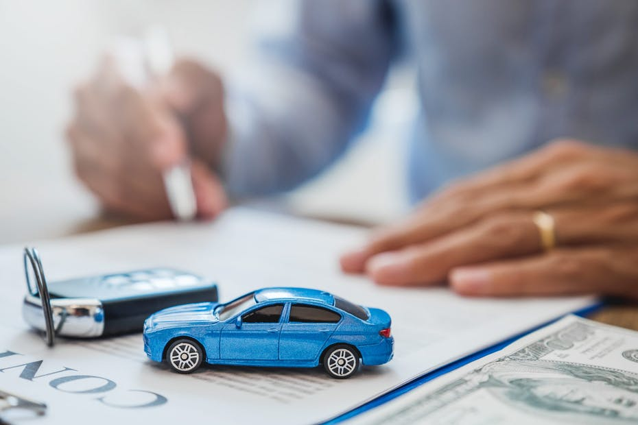 signing paperwork for a car and keys