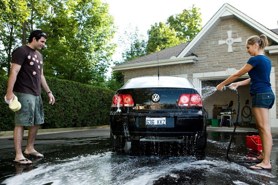 Couple washing car
