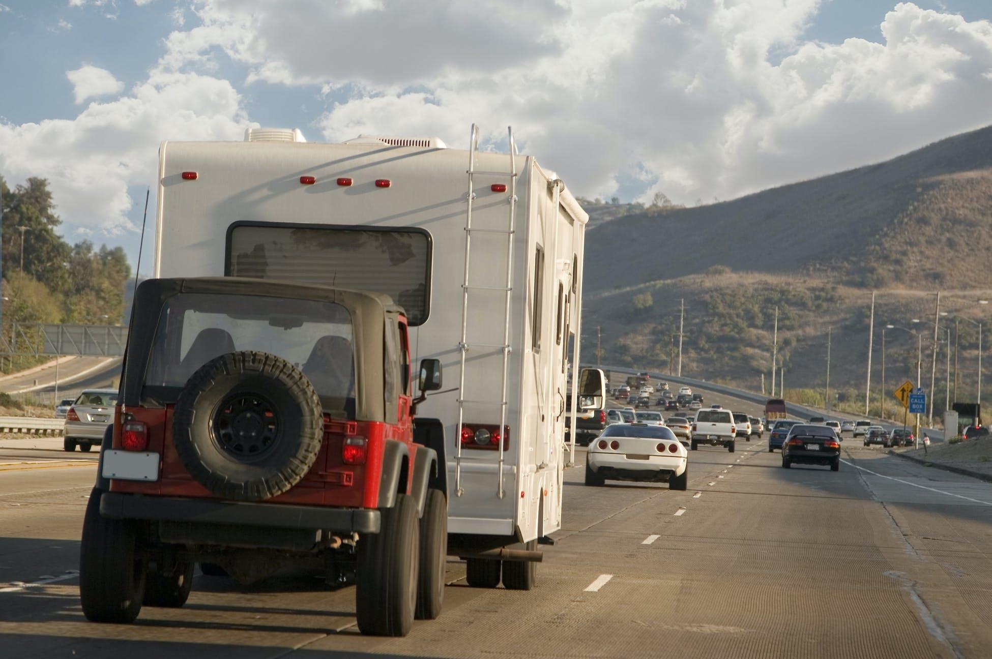 RV pulling Jeep